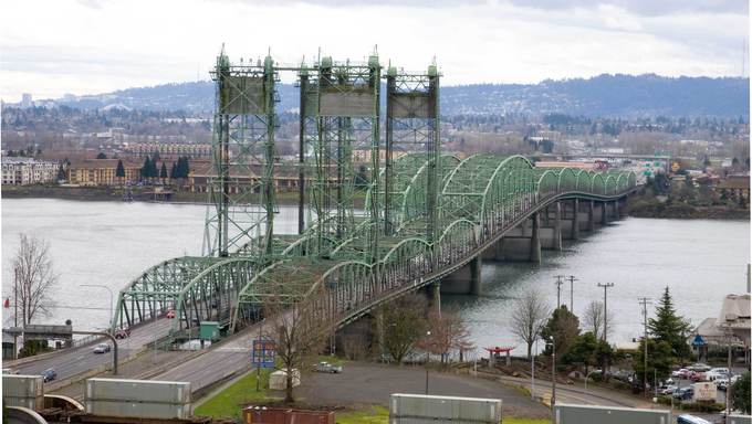 Interstate bridge connecting to Vancouver, WA with a beautiful view in the background.