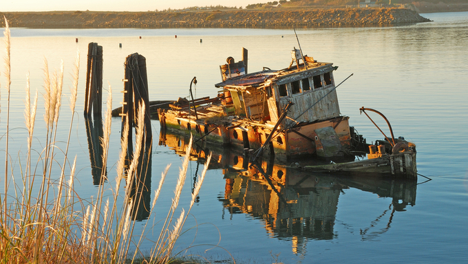 Mary D. Hume lying in the still water's of the Rogue River Bay near Gold Beach.  Boat originally built in 1881.