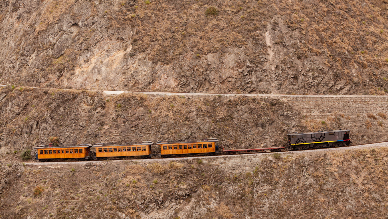 Train going up on Nariz del Diablo, very important tourist attraction in Ecuadorian Andes, one of the highest railorad route in the world