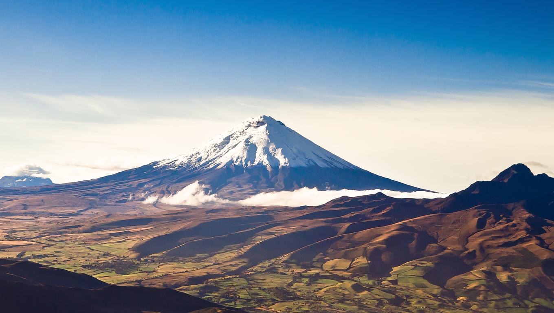 Cotopaxi volcano, Ecuador aerial shot with blue skyes