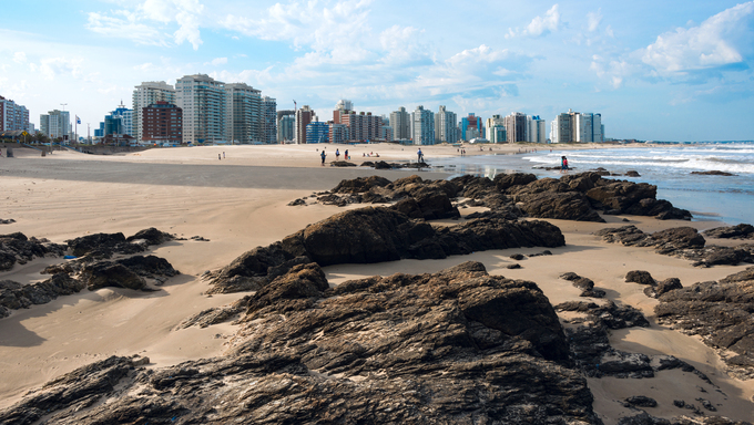 Residents of Punta del Este on the beach during an unusually hot weekend in Maldonado.