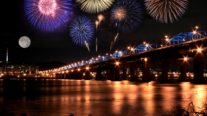 Spectacular fireworks and a full moon at the Han River in Seoul.