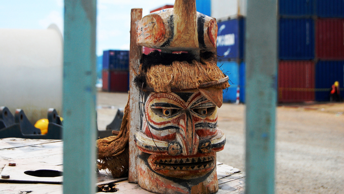 Timber mask in Port Moresby port, industrial area of the city, Papua New Guinea