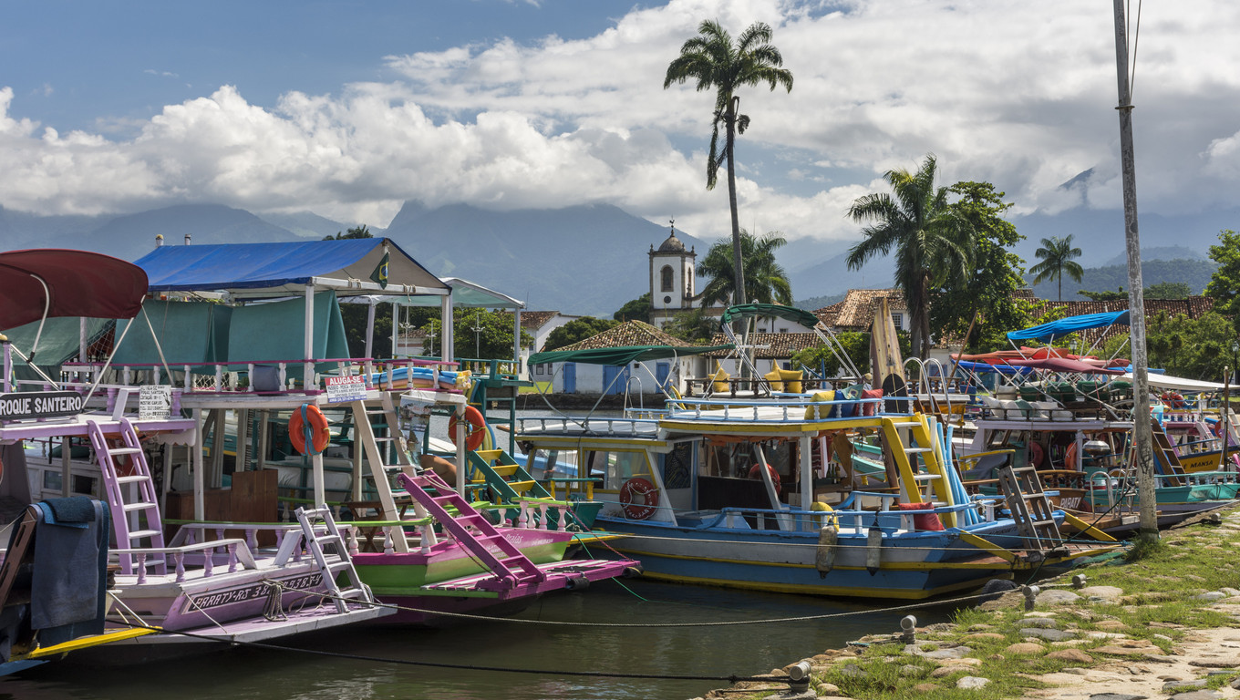 Tourist boats in the pier of historic colonial city of Paraty, Costa Verde region in south Rio de Janeiro, Brazil