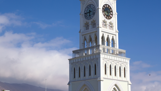 IQUIQUE, CHILE - JANUARY 22, 2015: The Torre Reloj (clock tower) from the year 1877 on Plaza Prat main square on January 22, 2015 in Iquique, Chile. Iquique is a free port city in Northern Chile.