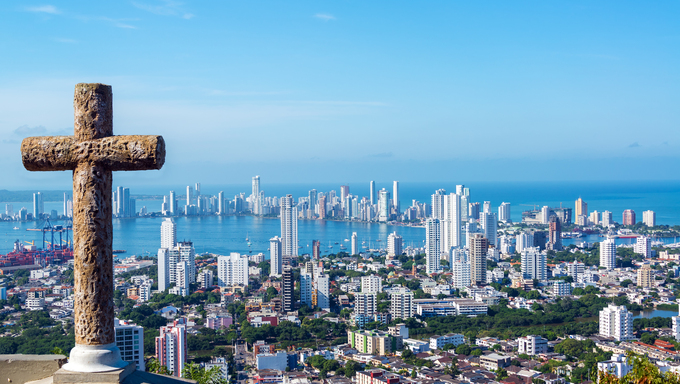 View of the modern part of Cartagena, Colombia with a stone cross in the foreground