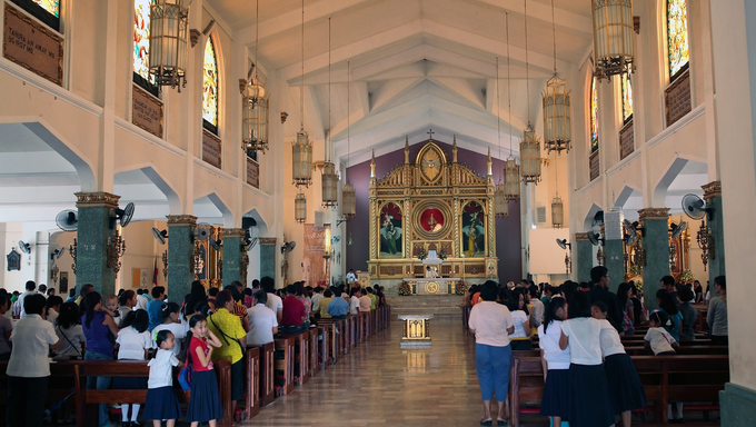 Filipino Christian people attending Sunday mass in a Catholic church in Tacloban, Philippine Islands.