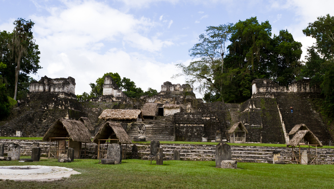 Ancient Mayan ruins in Tikal Guatemala half covered and underground