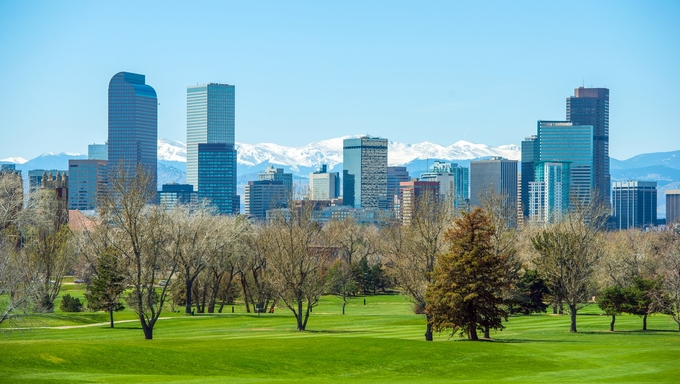 Sunny Denver Skyline. Spring in Colorado. Denver Skyline and Snowy Rocky Mountains.