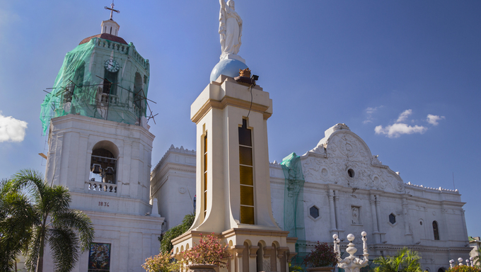 Beautiful white colonial cathedral with deep blue sky