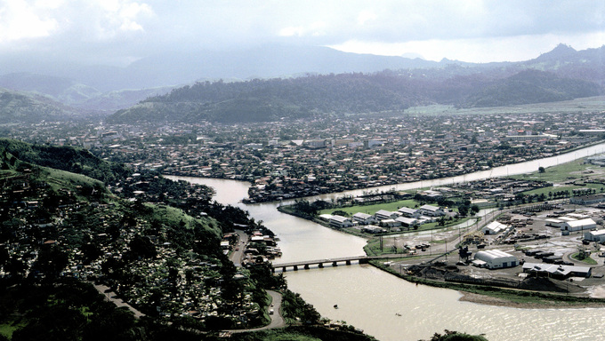 An aerial view of the city of Olongapo.  The bridge that leads to the Naval Base, Subic Bay, is visible at bottom right.