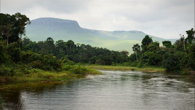 Small river in jungle. Under the cloudy sky through hills and mountains the small river proceeds on jungle.