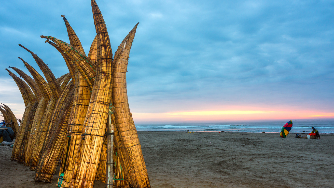 Traditional Peruvian small Reed Boats (Caballitos de Totora), straw boats still used by local fishermens in Peru