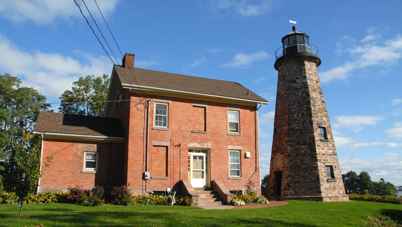 Historic stone lighthouse on Lake Ontario, Rochester, New York.