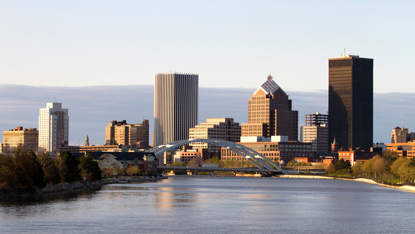 Rochester, New York, USA skyline viewed from the south at dusk with the Genesee River flowing toward the downtown area.