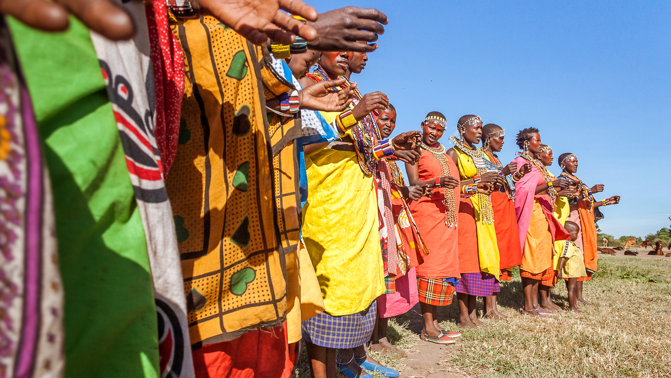 Masai Mara, Kenya, May 23, 2017: Masai women in traditional costume lined up during a ceremony